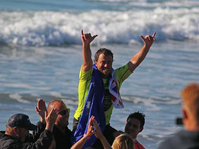 Emerald Beach longboard surfer Paul Scholten celebrates a hometown victory at the bcu Australian Surf Festival.