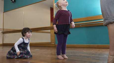 Alexandra Crawley (left) and Sophia Fox watch their teacher Sarah Brown during baby ballet classes