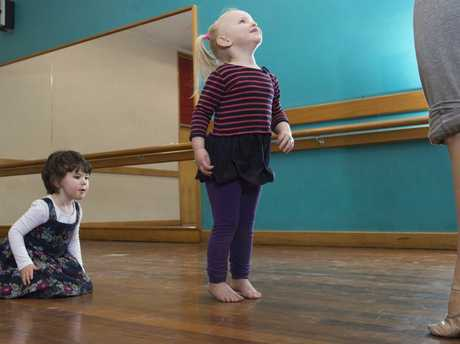 Alexandra Crawley (left) and Sophia Fox watch their teacher Sarah Brown during baby ballet classes