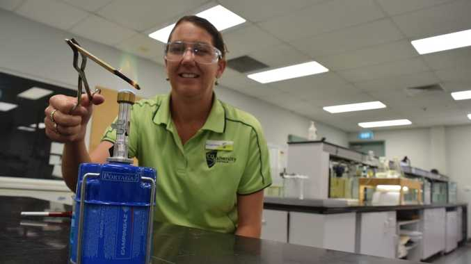 FLAME TEST FUN: CQUniversity Research Fellow Dr Linda Pfeiffer burning copper. Dr Pfeiffer is determined to bring the fun to trainee science teachers.