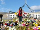 FLOWER POWER: Members of the Christian Federation arrange flowers in front of Parliament House in Canberra, yesterday.