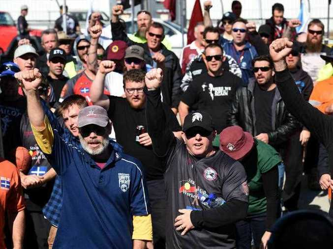 Trade union members chant as they block the entry road to Berth 11 at the Port of Brisbane, Monday, Aug. 10, 2015. Protesters have gathered at the port of Brisbane and in Sydney, furious with Hutchison Ports for sacking 97 staff across the two cities late last Thursday night via text and email, citing substantial financial losses.