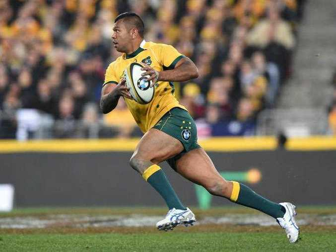Wallabies player Kurtley Beale with possession during the Rugby Championship and Bledisloe Cup match between Australia and New Zealand at ANZ Stadium in Sydney, Saturday, Aug. 8, 2015.