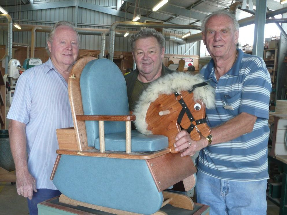 Brain, Dave and Ron with the novel rocking horse a youngster would enjoy.