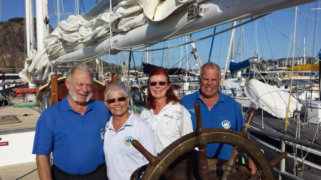 Captain, John Davis with Cath Downie of Kingscliff, NSW, Robyn Elkington of Manly and Graham Dix of Maryborough aboard the South Passage.