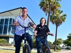 AUGUST 2015: Youi wins national Human Resources award for its policy for its staff. (from left) Dion Locke and Mary Maclean use company bikes around the lake outside the Youi offices on Lake Kawana Boulevard. Photo: Che Chapman / Sunshine Coast Daily