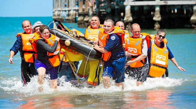 ON THE MOVE: Woolgoolga Marine Rescue members train with life raft recovery at Coffs Harbour Jetty. The relocation of Woolgoolga's Marine Rescue service to Arrawarra Headland is on the council agenda.