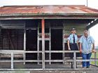 BACK HOME: Ipswich Police's Charysse Pond and Cr David Pahlke inspect the old Rosewood police lock-up.