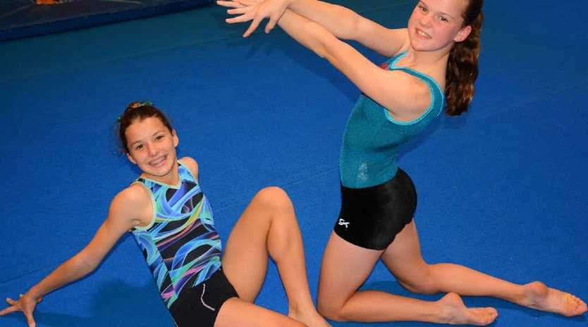 REACHING FOR THE STARS: Ainsley Graham and Chloe Martin are two athletes in a strong Gladstone Gymnastics Club team heading to Regional Championships this weekend in Rockhampton.