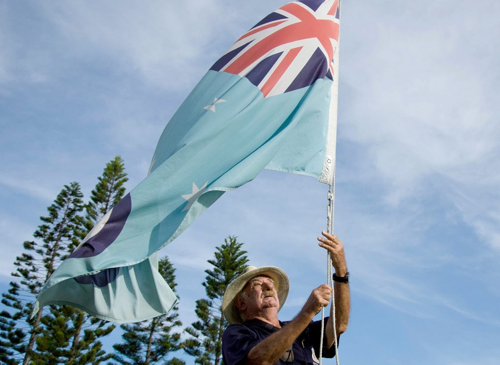 David Bird has raised the flags in Yeppoon every day for the last 20 years. His photo will be part of the ABC Open Unsing Heroes exhibition coming up. Photo Contributed / The Capricorn Coast Mirror