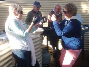 Probus club members shadow box to warm up