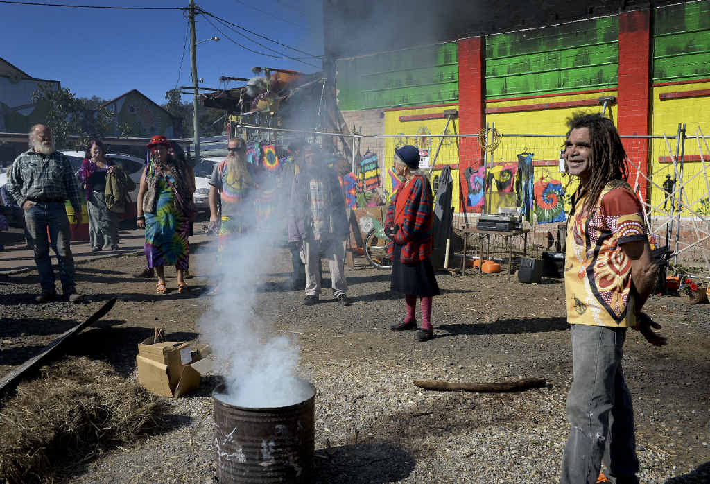 Gilbert Laurie, doing a smoking ceremony on the one year anniversary of the Nimbin fire which destroyed the museum. Photo Mireille Merlet-Shaw / Northern Star