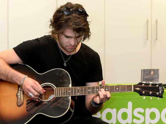 THE X-FACTOR: Dean Ray performs for Rockhampton's Headspace centre.