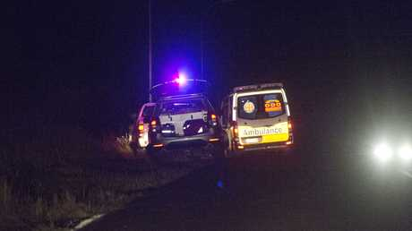 Queensland Ambulance crews meet on the side of the road between Biddeston and Toowoomba with the family of a boy injured by a lawnmower.