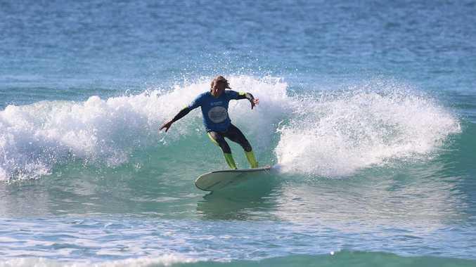 Emerald Beach surfer John Schmidenberg in action during the over-40s Australian Longboard Titles final at the bcu Australian Surf Festival.