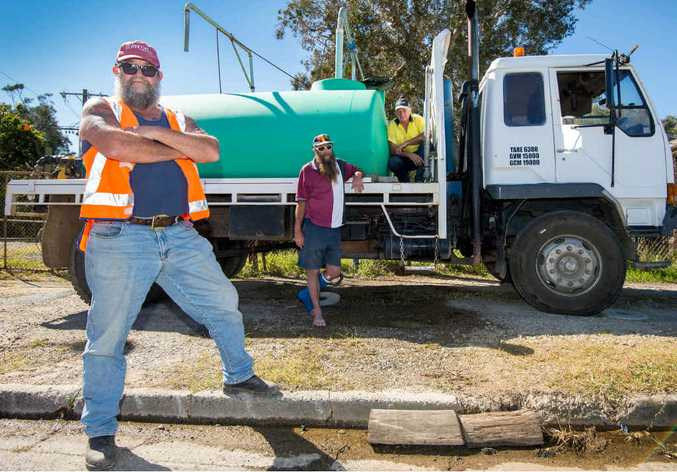 ANGRY: Water carters Darryl Schofield, Ken Ford and Jim the driver. Trevor Veale