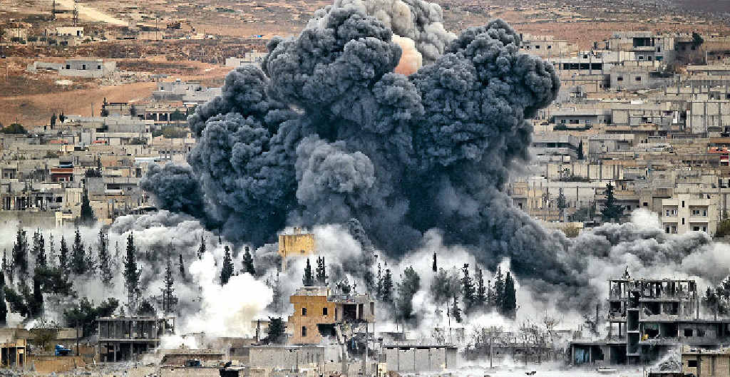 AIR STRIKE: Smoke rises from the Syrian city of Kobani.
