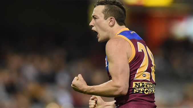Pumped ... Lewis Taylor kicks one of his three goals against the Gold Coast last week. Photo: AAP