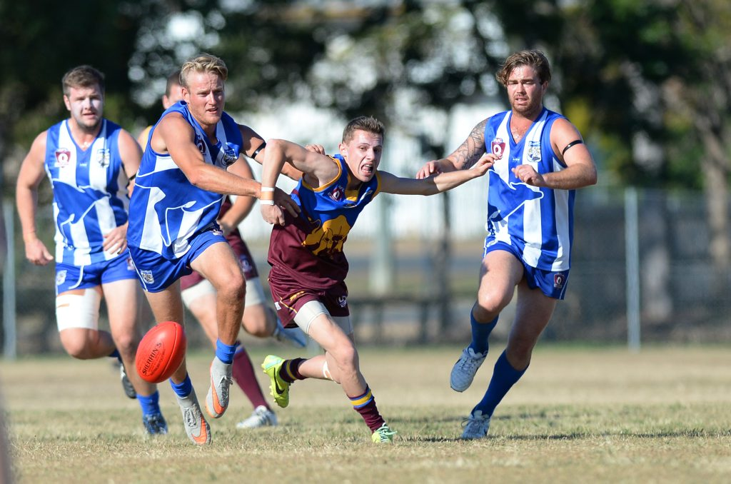 Glenmore player Bradley Maxwell races Brothers palyers to a loose ball during the AFL game between Brothers and Gracemere Bulls at Kele Park on Saturday. Photo: Chris Ison / The Morning Bulletin