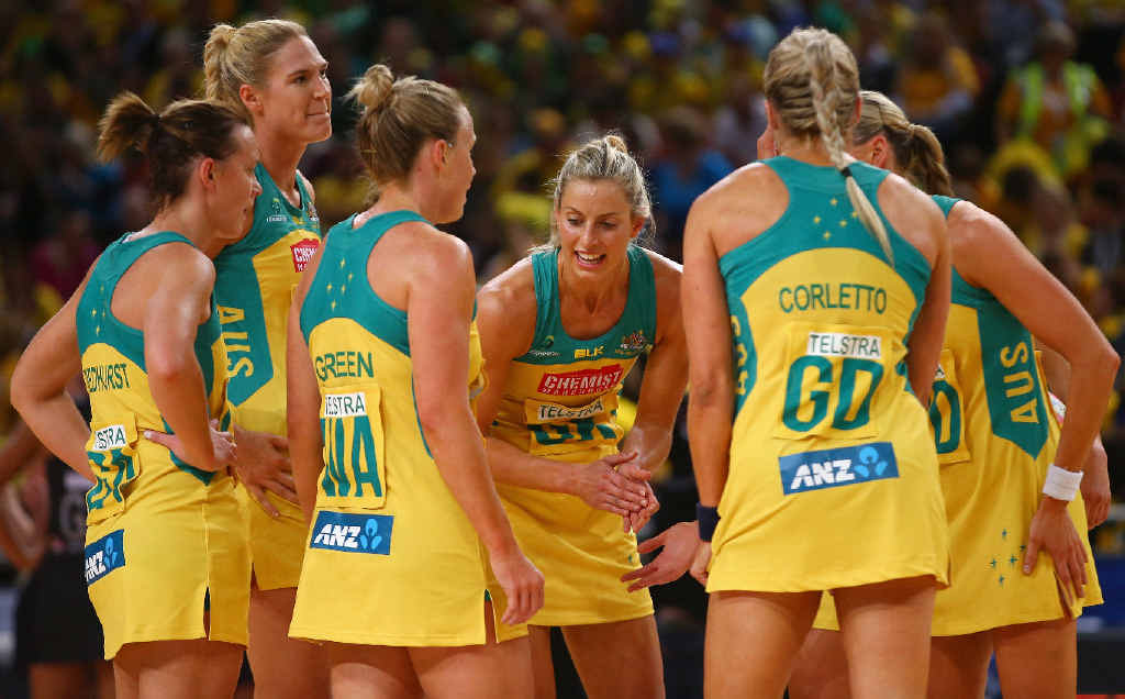 VICTORY: Laura Geitz speaks to her Australian Diamonds team in a huddle during the 2015 Netball World Cup grand final victory in Sydney.