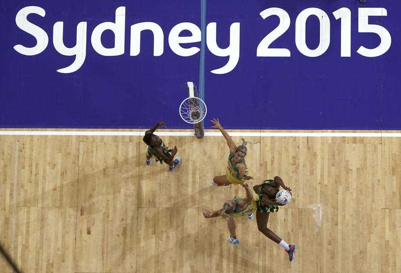 Australia's Julie Corletto, top right, and Laura Geitz bottom left, battle with Jamaica's Shanice Beckford left, and Romelda Aiken, right, during their Netball World Cup semi final in Sydney, Australia, Saturday, Aug. 15, 2015.