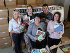 READING UP: Kate Darvall, Katherine Morris, Natasha Lumley, Darrin Kefford and Shannon Newley dig into Taabinga Rotary Club's Bookarama stock.