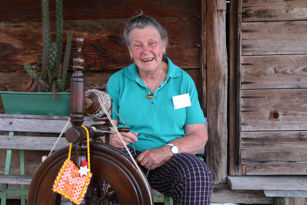 Marion Darlington spins some wool in memory of Boondooma's early sheep grazing days.