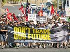 Union members march in Gladstone over the China Australia free trade deal.