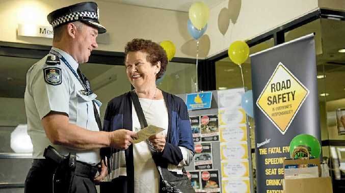 ROAD AWARE: Chief Inspector Darren Somerville shares a few road safety tips with Gladys Pitt, 74, who has been driving since 1959.