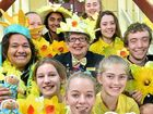 YELLOW GLOW: Cancer survivor Christine Jones with Nambour High School students and their daffodils.