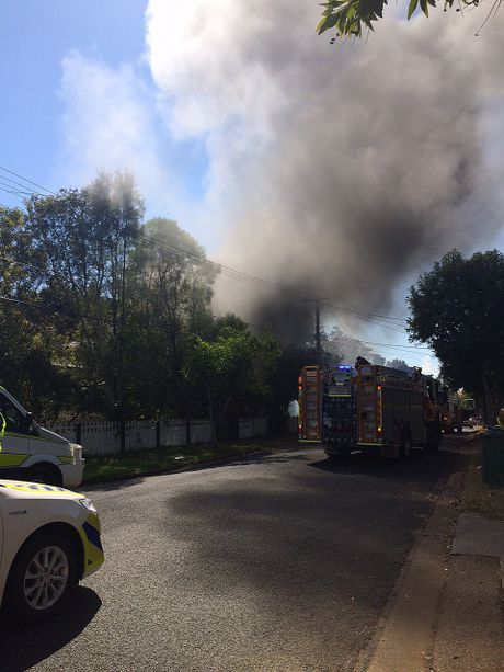 Firefighters at the scene of a fire at a property on Sturt St at Leichhardt.