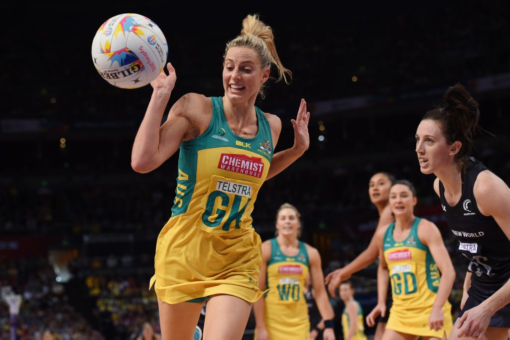 Laura Geitz (left) of Australia competes for the ball with Bailey Mes (right) of New Zealand during their preliminary round match of the Netball World Cup at Allphones Arena in Sydney on Sunday, Aug. 9, 2015. (AAP Image/Paul Miller) NO ARCHIVING, EDITORIAL USE ONLY