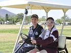 "Acting Senior Constable Kellie Knight and North Rockhampton High School captain Laura Gilbar test out ""beer goggles"" in a golf buggy as part of Queensland Road Safety Week. Photo Michelle Gately / Morning Bulletin"