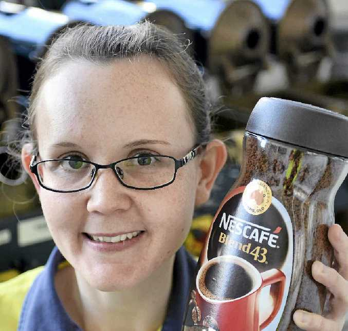 WAKE UP GYMPIE: Adrienne Bell at the Nestle factory yesterday with its famous Blend 43.