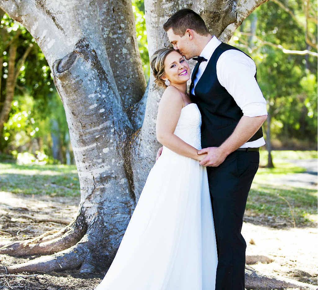FAMILY SURPRISE: Sam and Matt Merritt photographed at Tondoon Botanic Gardens by Kirtsen Cunningham before their surprise wedding.
