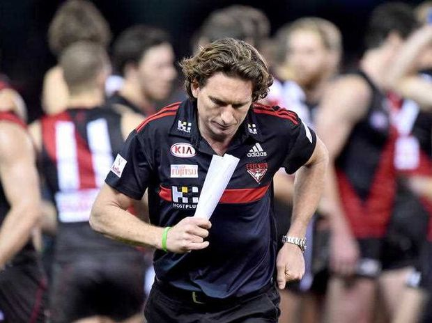 Bombers head coach James Hird walks back to the coaches box after speaking to his players at the break, during the round 20 AFL match between Essendon and the Adelaide Crows, played at Etihad stadium in Melbourne, Saturday 15 Aug. 2015.