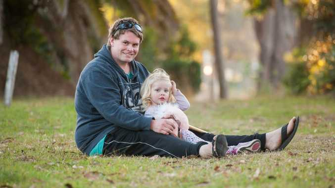 Ryan Crouch, with his daughter Harmony, is hoping to bring Ryan's youngest daughter Lilli home to Coffs Harbour.