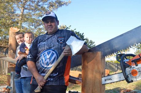 FAMILY MAN: Grafton woodchopper Chris Owen with partner Niki Phillips and son Will (15 months) ahead of this weekend's Stihl Timbersports Series. PHOTO: BILL NORTH
