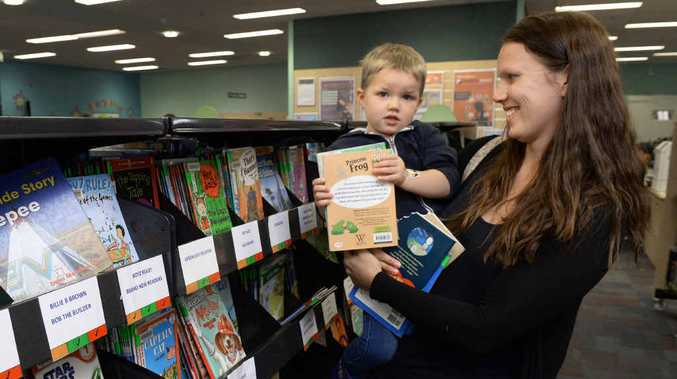 READY TO READ: Emma Peeters with son Luke, 3, at the Ipswich Library.