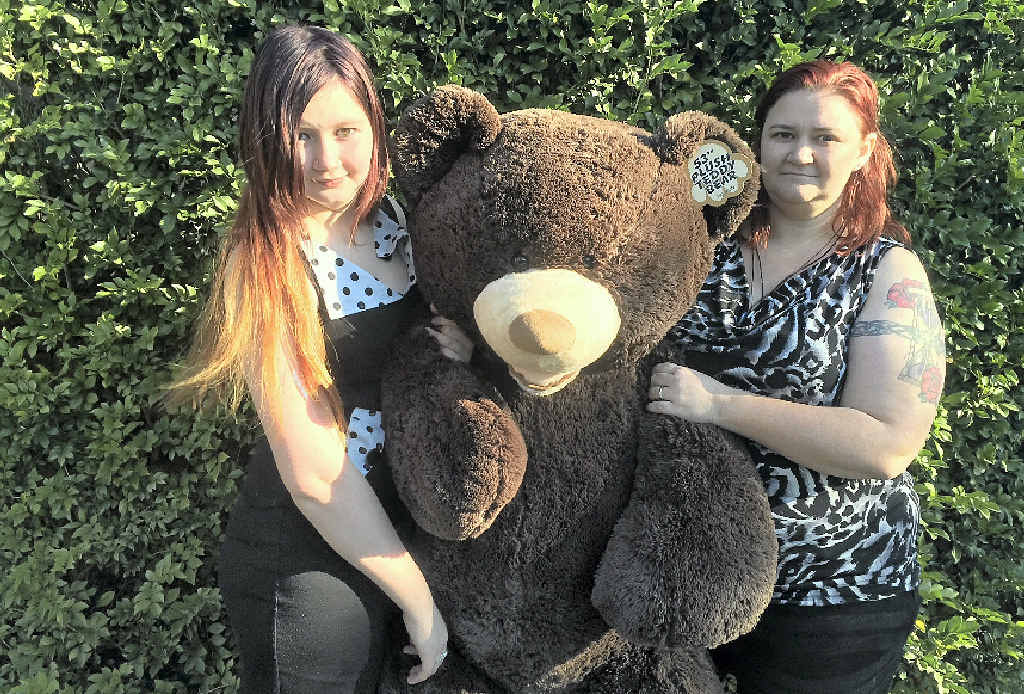 DISAPPOINTED: Year 11 Tullawong High School student Jourdan Marden with mum Samantha and a giant teddy bear raffle prize, bought as part of the drive to raise money for orphans in Cambodia.