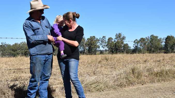 Nathan and Tammy Harch with their two-year-old daughter at their now recovering Jambin farm. (3) Photo Emma Clarke / Central Telegraph