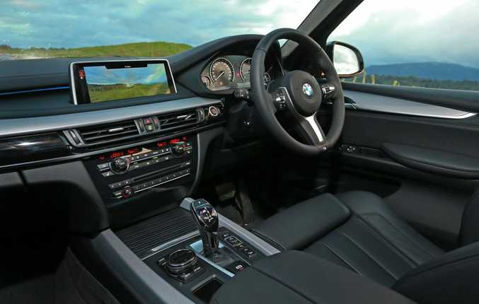 ALL CLASS: Giant 26cm colour screen part of a typically stylish BMW cabin