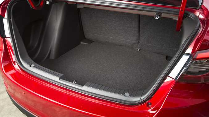 BOOTED: Mazda2 Sedan offers 440-litres of cargo space to the Hatch version's 250. It is still trailing in the Honda City's 536-litre wake however.