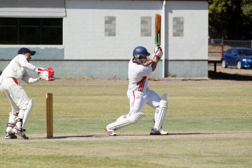 First drop Isaac Jones drives the ball to the boundary. Photo Matthew Holdsworth / CQ News