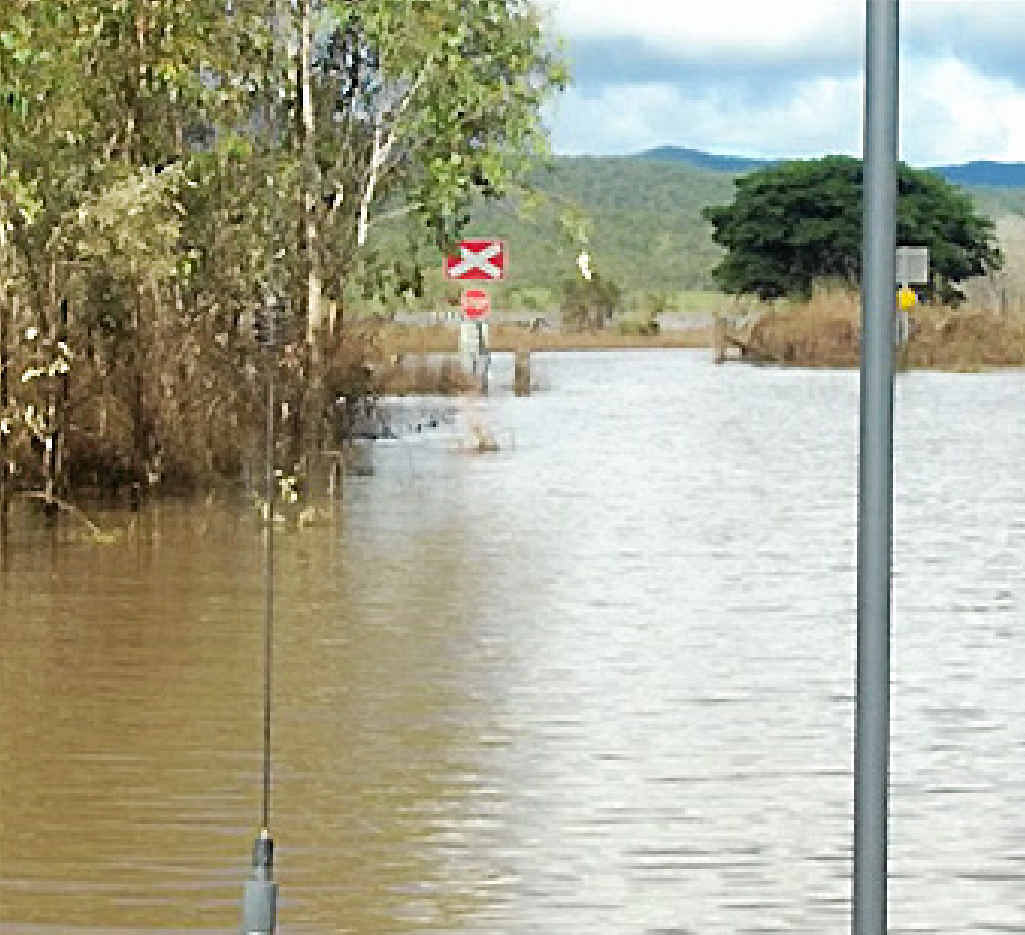 UNDERWATER: Not only were parts of Monto Rd flooded but sections of rail were also cut off by water.