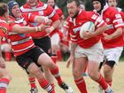 St George's Brett Watts palms off a defender during his team's round one clash with Toowoomba Rangers at Dirranbandi.