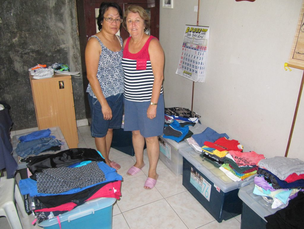 Virgie Cox and Val Corfield sorting through uniforms for the children from Kitcharao. Photo Contributed