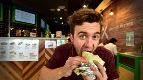 Zambrero has restaurants across Queensland, including this one at Mooloolaba, where Luke Simmonds is tucking into a burrito.