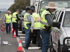 Police and Department of Transport officers on the Warrego Hwy near Jondaryan during a operation during Road Safety Week.