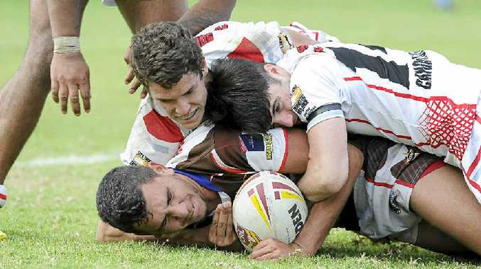 SECOND CHANCE: A Sawtell player is tackled by South Grafton opponents during last week's Under-18s preliminary final at Coffs Harbour. PHOTO: DEBRAH NOVAK